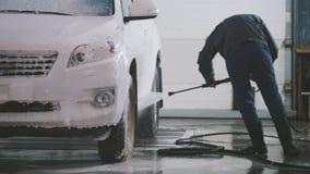 Lavando um carro nos Sul - serviço de SUV do carro Imagem de Stock