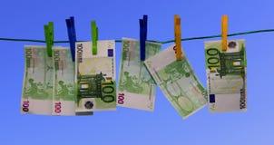 Lavare e di soldi Immagini Stock