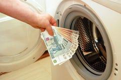 Lavare e di soldi Fotografie Stock