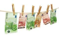 Lavare e di soldi sul clothesline Fotografia Stock Libera da Diritti