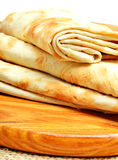 Lavash, tortilla wrap Bread on the cutting board on white Royalty Free Stock Images
