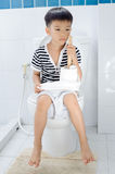 Lavatory toilet and boy Royalty Free Stock Photo