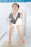 Lavatory toilet and boy Royalty Free Stock Photo