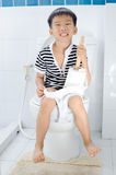 Lavatory toilet and boy Royalty Free Stock Image