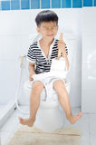 Lavatory toilet and boy Royalty Free Stock Photos