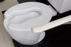Lavatory toilet for elderly people. The design of lavatory toilet for elderly senior people stock photo