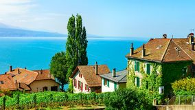Lavaux, Switzerland - August 30, 2016: Chalets in Vineyard Terraces hiking trail of Lavaux, Lake Geneva and Swiss mountains,. Lavaux-Oron district in royalty free stock image