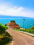 Lavaux, Switzerland - August 30, 2016: Road at Lavaux Vineyard Terraces hiking trail, Lake Geneva and Swiss mountains, Lavaux-Oron. District, Switzerland royalty free stock images