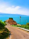 Lavaux, Switzerland - August 30, 2016: Road at Lavaux Vineyard Terraces hiking trail, Lake Geneva and Swiss mountains, Lavaux-Oron. District, Switzerland stock image