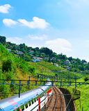 Lavaux, Switzerland - August 30, 2016: Running train near Lavaux Vineyard Terraces hiking trail, Lavaux-Oron district, Swiss. Lavaux, Switzerland - August 30 royalty free stock photo