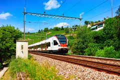 Lavaux, Switzerland - August 30, 2016: Running train at Lavaux Vineyard Terrace hiking trail, Lavaux-Oron district, Switzerland. Lavaux, Switzerland - August 30 royalty free stock photo