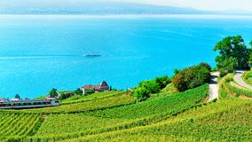 Lavaux, Switzerland - August 30, 2016: Running train in Lavaux Vineyard Terraces hiking trail and ship at Lake Geneva and Alpine. Mountains, Lavaux-Oron royalty free stock images
