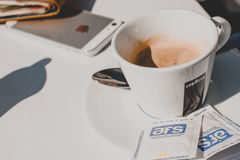 Lavazza cup of coffe and iPhone Stock Photo