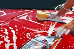 Lave-auto sexy de femme Photo stock