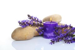 Lavendar spa concept. Stone, candle and a bunch of lavender on white background royalty free stock photos