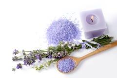 Lavendel, salt hav och stearinljus på en vit bakgrund Royaltyfri Foto