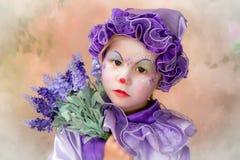 Lavendelclownflicka royaltyfri bild