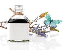 Lavendelolie en bloemen royalty-vrije stock foto's