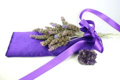 Lavender and Amethyst. Bunch of lavender on satin pillow with amethyst crystal against white background Stock Photography