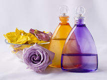 Lavender and arnica oil, rose petals Stock Images