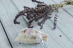 Lavender aroma bag on wooden background Stock Photos
