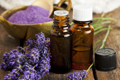 Lavender Aromatherapy. Bottles of aromatherapy essence and bath salt with lavender flowers closeup Stock Images