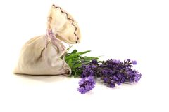 Lavender bag with fresh flowers and leaves. Lavender bag with fresh flowers and green leaves on a light background royalty free stock photo