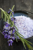 Lavender bath salts. Herbal body care product with fresh flowers close up Royalty Free Stock Photo