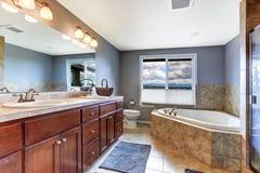 Lavender bathroom with mocha tile bath trim Royalty Free Stock Image