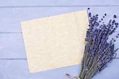 Lavender and Blank Paper. Overhead view of a bundle of dried lavender flowers with an old piece of paper with copy space Royalty Free Stock Photography