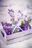 Lavender in bottles decor Stock Images