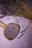 Lavender flowers flat lay. Lavender bouquet with loose sprigs and an old wooden spoon with dried flowers. Flat lay retro style Royalty Free Stock Photography