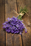 Lavender bouquet on rustic wooden table Stock Photos