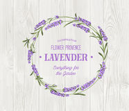 The lavender bouquet. The lavender bouquet with text template over wooden texture. The lavender elegant card. Vintage postcard background vector template for Stock Photos