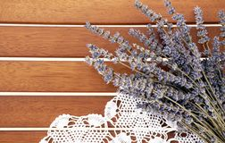 Lavender bunch and white lace on the wooden background stock photos