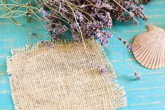 Lavender spa concept. Lavender and burlap cloth on turquoise wooden background Stock Photography