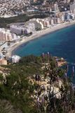 The lavender bush on Mount Ifach, the blue sea and the coastal town of Kalp on the Mediterranean coast in Spain, the Costa Blanca. Region stock photos