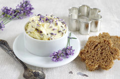 Lavender butter. Homemade lavender butter with lavender blossoms royalty free stock image