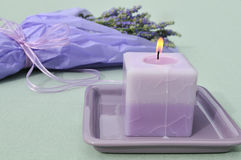 Lavender candle and flower bouquet Royalty Free Stock Photo