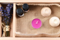 Lavender and candle. With oil theraphy in a wood box Royalty Free Stock Photos