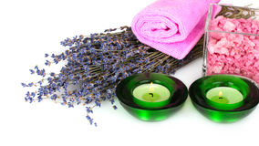 Lavender candle and towel Stock Photos