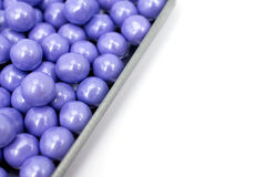 Lavender colored candies in a tin tray Stock Images