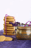 Lavender Cookies with Sugar and flowers on purple paper Stock Image
