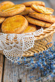 Lavender cookies in a wicker basket. Stock Images