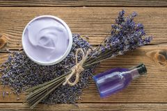 Lavender cream or balm, essential oil and bunch of dried flowers. Top view, flat lay royalty free stock photography