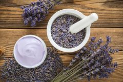 Lavender cream or balm, mortar of dry lavender and bunch of dried flowers. Top view, flat lay stock photography