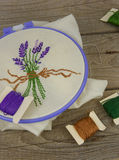 Lavender embroidery on a wooden table Stock Images