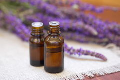 Lavender essential aroma oil. And lavender flowers Stock Photos