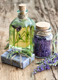 Lavender essential oil, herbal soap and bath salt with fresh flo Stock Images