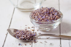 Lavender essential oil ingredients. Wooden spoon full of dry lavender seeds and bunch of dried lavender flowers with. Dry lavender flowers and essential oil on Royalty Free Stock Photos